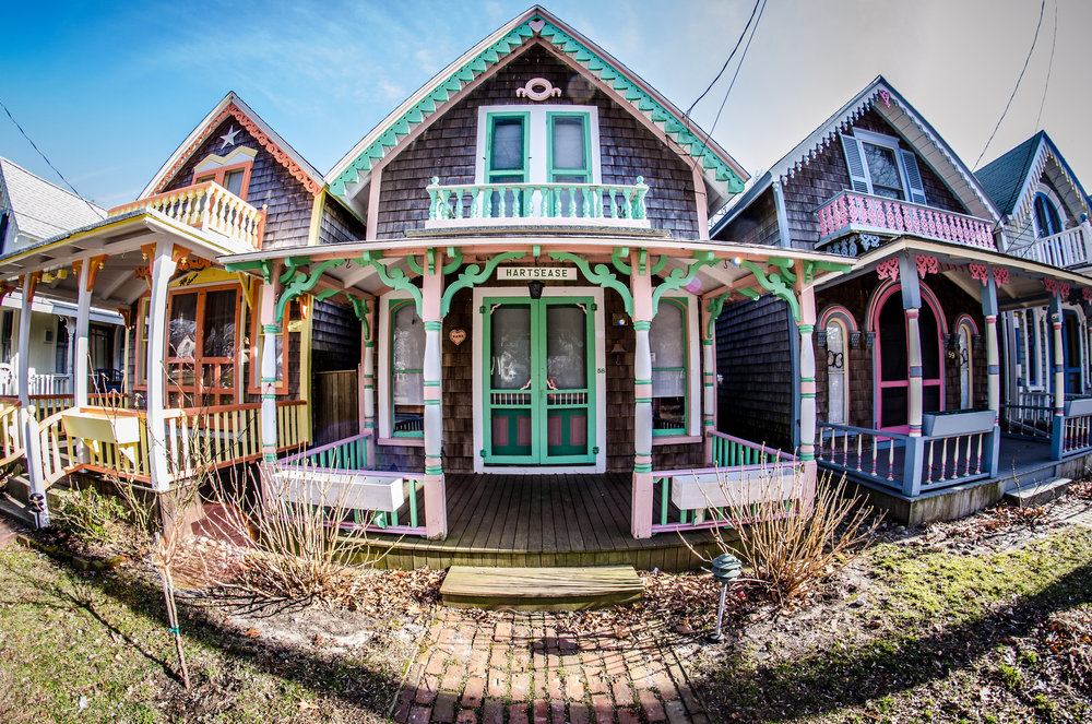 image ©  Flickr   The image above, is a series of gingerbread homes located in Martha's Vineyard in Oak Bluffs, Massachusetts, USA.