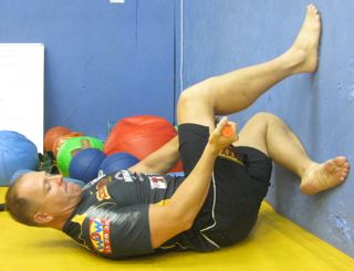 using the Tiger Tail to roll the lower hamstring in a flexed hip and knee position