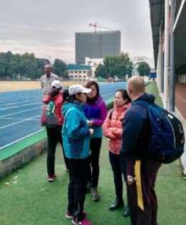 The lovely Naomi Li in the orange puffy jacket translating the conversation between a Womens T & F Coach and myself