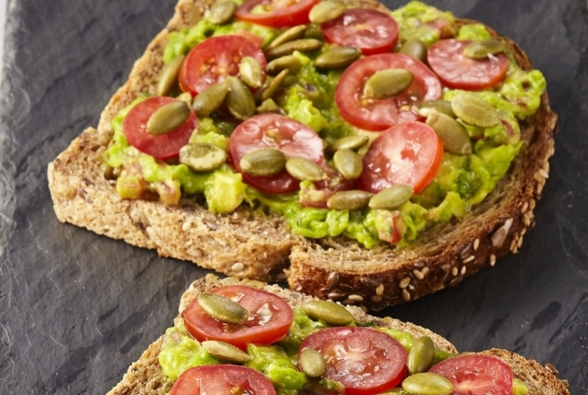 Wholey Guacamole  House made guacamole, tomato, pepitas and flake salt on whole grain health bread.   (2 pc/360cals)