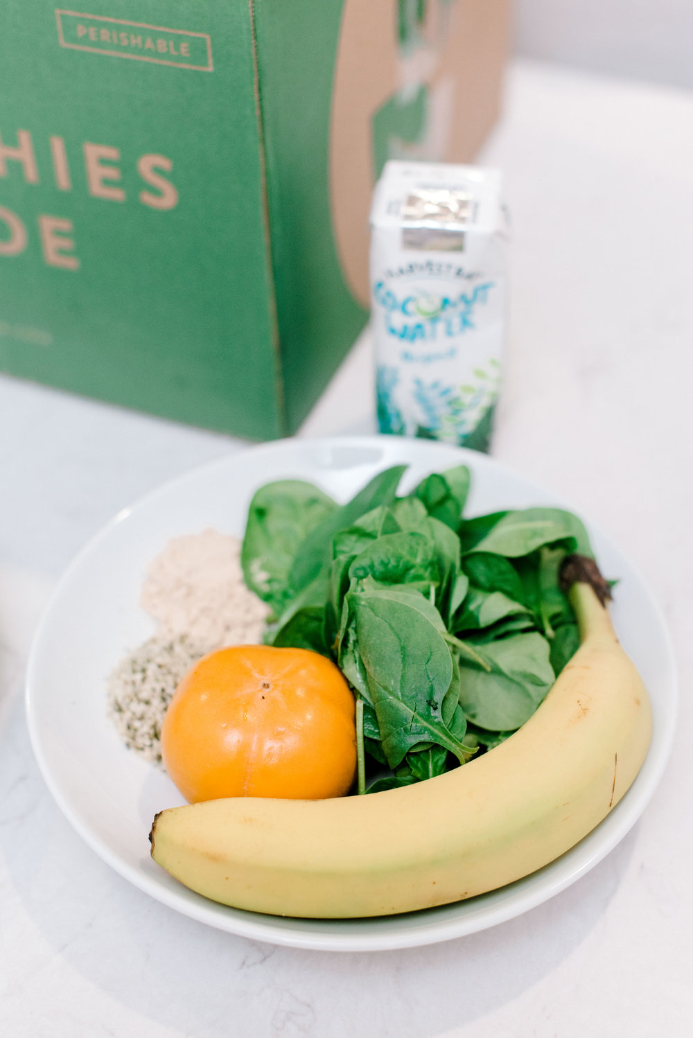 Persimmon Protein - 1 1/2 oz organic baby spinach1 organic banana, peeled1 persimmon, topped1 tbsp organic pea protein1 tbsp organic hemp seed1 cup coconut water,1 cup ice