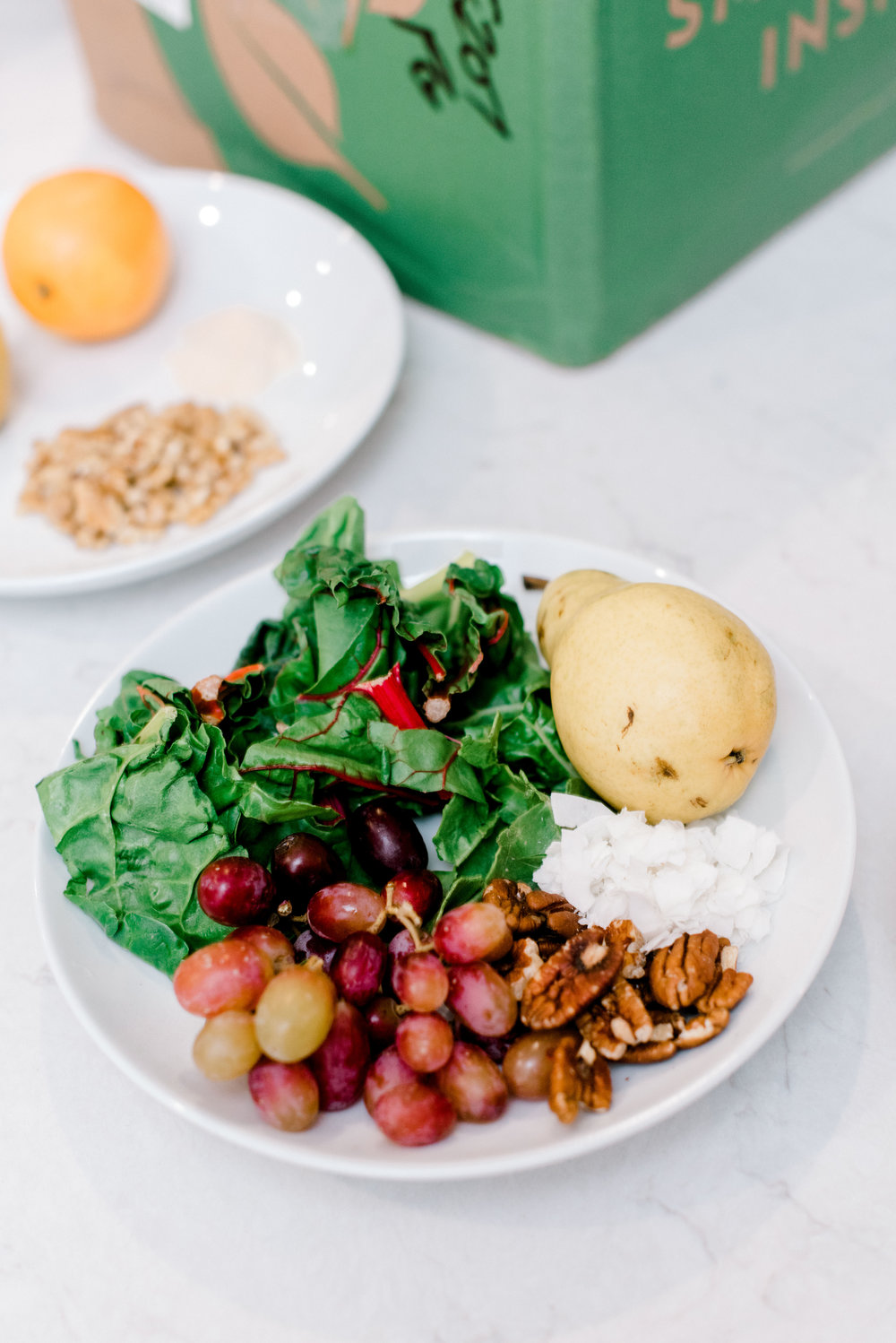 Coconut Pecan - 1 1/2 oz organic Swiss chard1 organic pear, chopped4 oz grapes3 tbsp organic pecans2 tbsp organic coconut flakes1 cup water, 1 cup ice