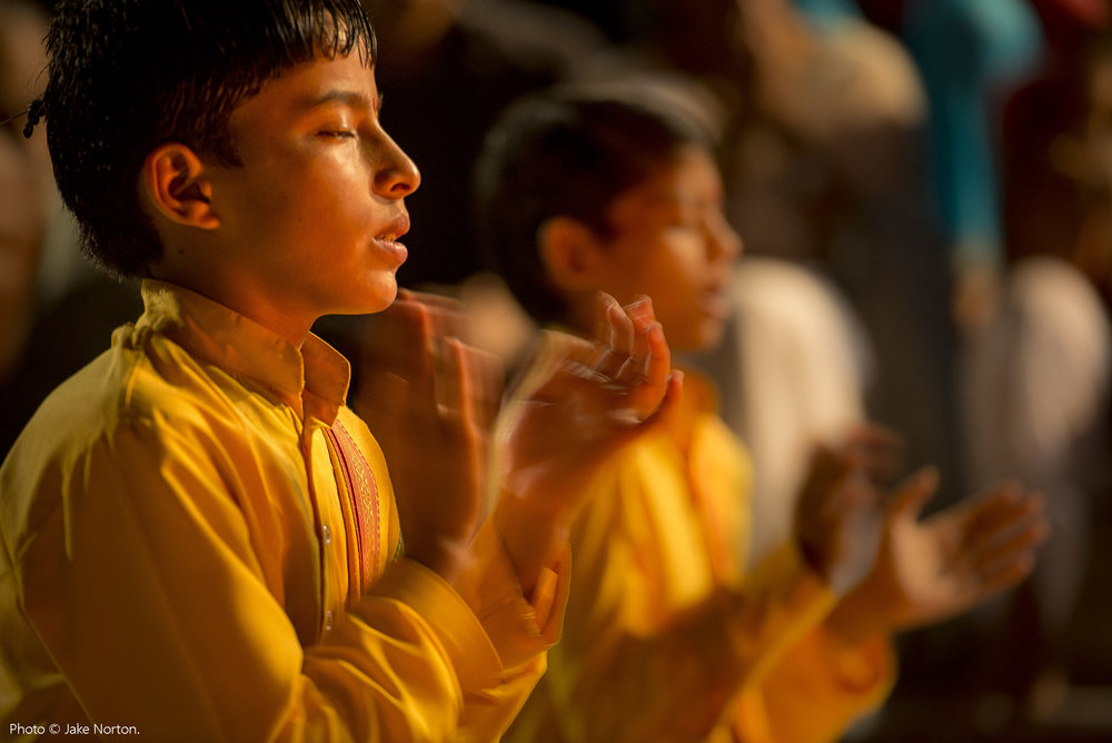 Young Hindu boys chant during Ganga aarti at Parmarth Niketan Ashram in Rishikesh, India. Photo © Jake Norton.