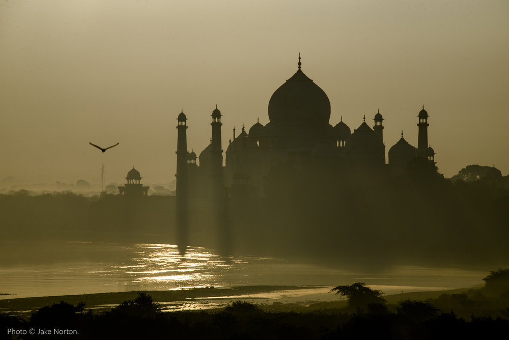The iconic Taj Mahal rises above the Yamuna River, one of the largest tributaries to the Ganges, and recipient of 80% of the raw, human waste from New Delhi. Photo © Jake Norton.