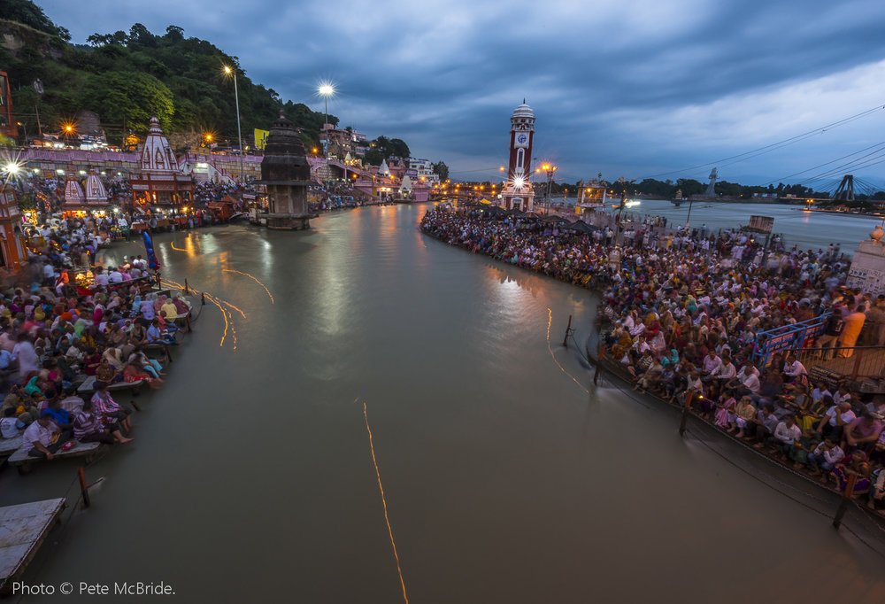 Diyas, or candle lamp offerings, trace their way down the Ganges River at Haridwar, Uttarakhand, India. Photo © Pete McBride.