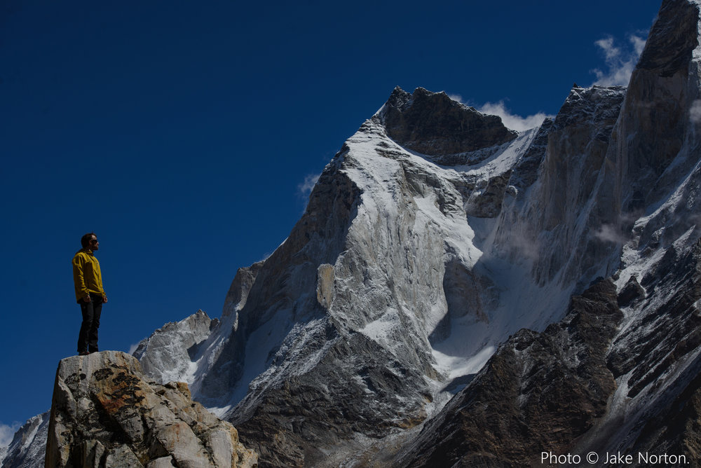 David Morton gazes up at the mighty Bhagirathi peaks from camp on the Gangotri Glacier, India. Photo © Jake Norton.