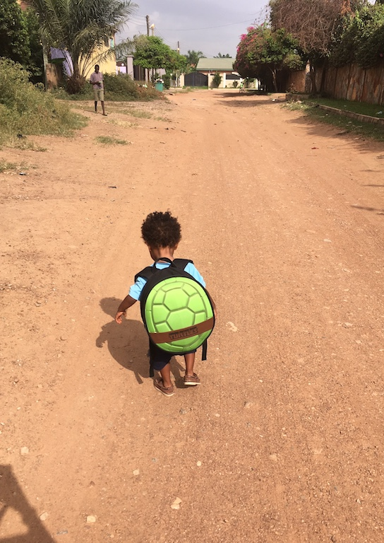Talib on his way to school. Just like a turtle, we carry home wherever we are.