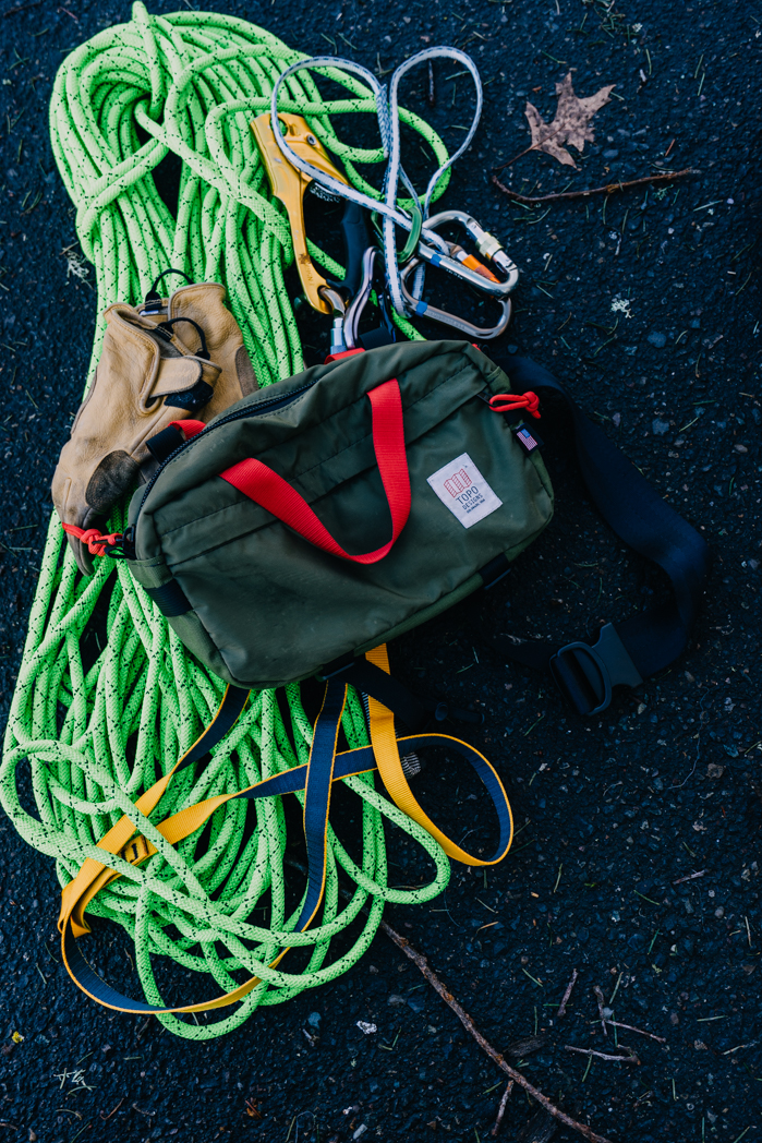Here's the TOPO Designs Hip Pack hanging with climbing gear.