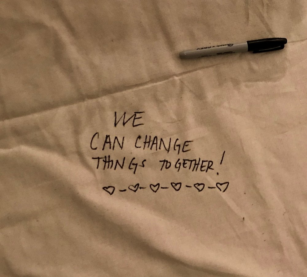 A note I wrote on a banner at an event I attended hosted by Evertown after the Parkland shootings. -
