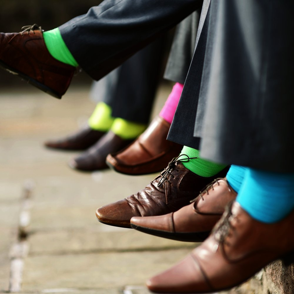 stock-photo-funny-colorful-socks-of-groomsmen-215585809.jpg