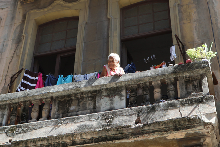 Waiting for the bread man from a balcony in Havana
