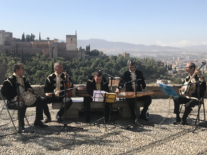 Traditional musicians posing in front of the Alhambra