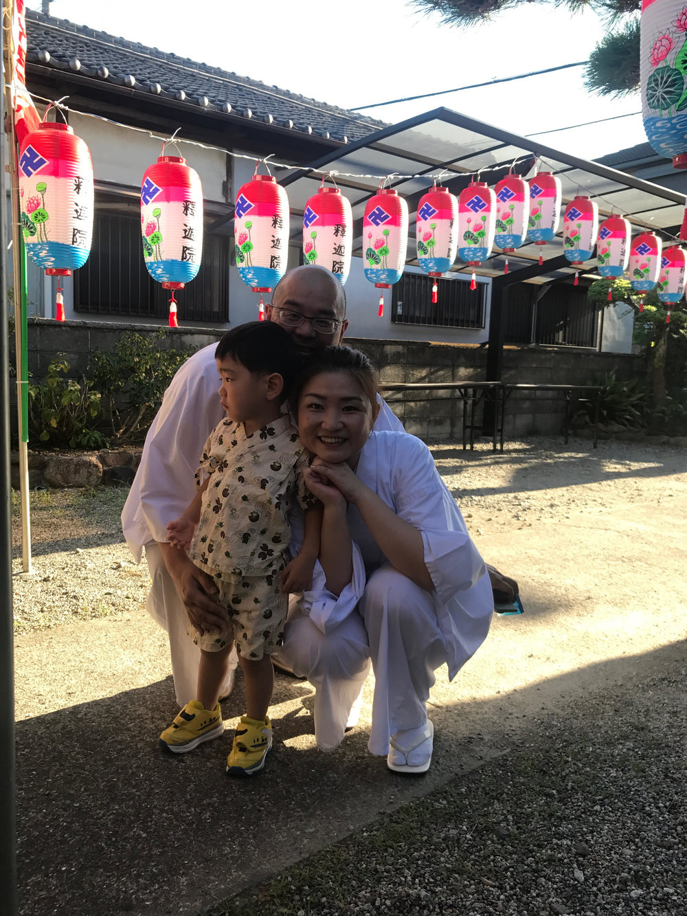 Just another day in the office: Saho's family outside the temple during preparations for children's festival day