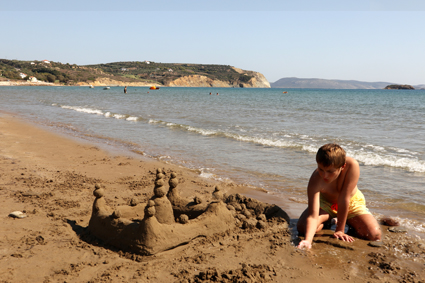 Helping Dad with his sandcastle, Greece