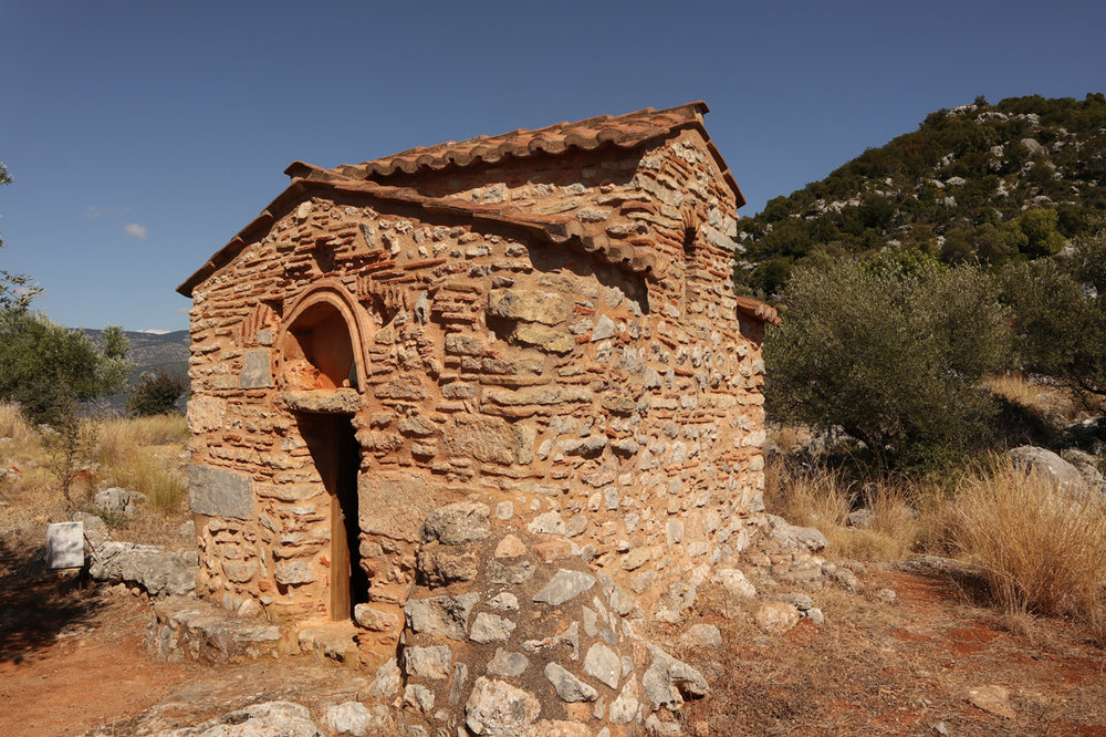 A typical tiny Maniot stone church - this one's Ayios Nikolaos, near Avia in the north of the Mani. You can still see remnants of Byzantine frescoes inside (below)