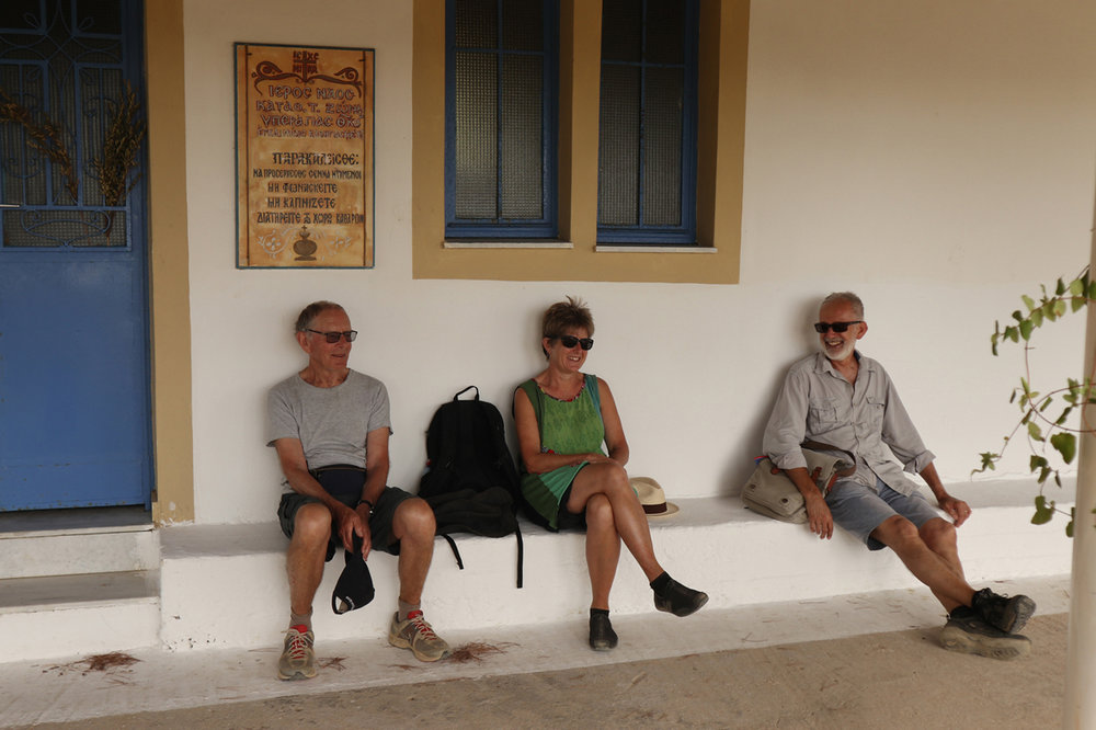 """A break on a handy church bench, during proceedings at my father's """"not-my-80th-birthday"""" walk around churches near Methoni. George Mandow, me, Paul Green, 22 October 2017"""