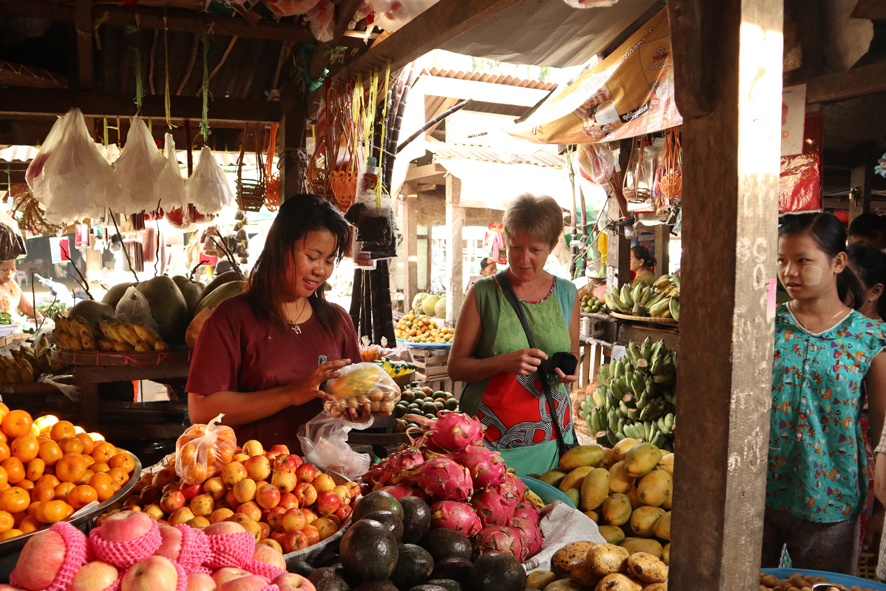 Stocking up on fruit and testing out my Burmese. Each stall is clean, with its beautiful piles of fruit, fish etc. But the mess outside the market is horrendous. All waste, including plastic bags etc is just dumped in the river, or in rotting heaps on the banks. Makes Greece look pristine!