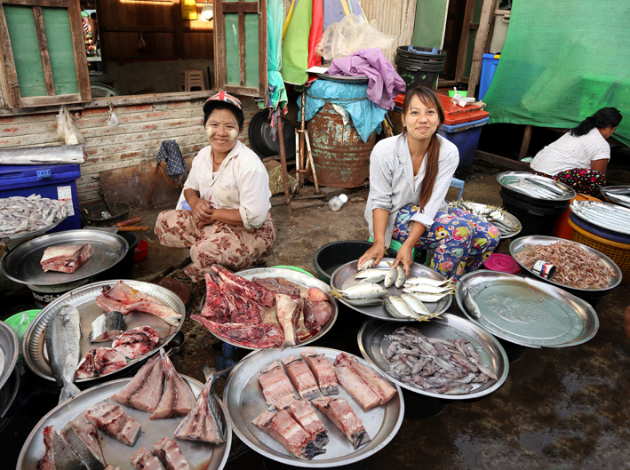 """Fabulous fish sellers. The """"mud"""" on their cheeks is called thanakha and is used by women, children and to a lesser extent men - even teenage boys - as a sunscreen and also for cosmetic purposes - ie to look beautiful."""