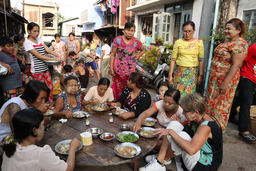 One morning in Mawlamyine we stumbled across this community breakfast and were literally dragged in to eat with everyone from the street. Organisers collect money from local individuals, shops and businesses and when they have enough, they put on a free street breakfast. We had noodle soup (chicken? fish?, I can't remember...) with chopped coriander and chilli. It was delicious. We sat on the ground on a sack. The photos below are the organisers cooking and serving up, and some school kids enjoying their food.