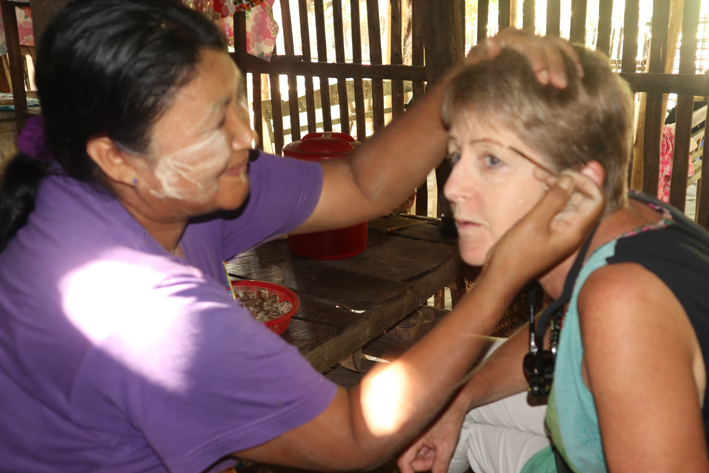 Getting my thanaka done - and my eyebrows highlighted with betel nut. Thanaka does feel a bit odd - like having a face pack on in the street, but is stangely cooling too.