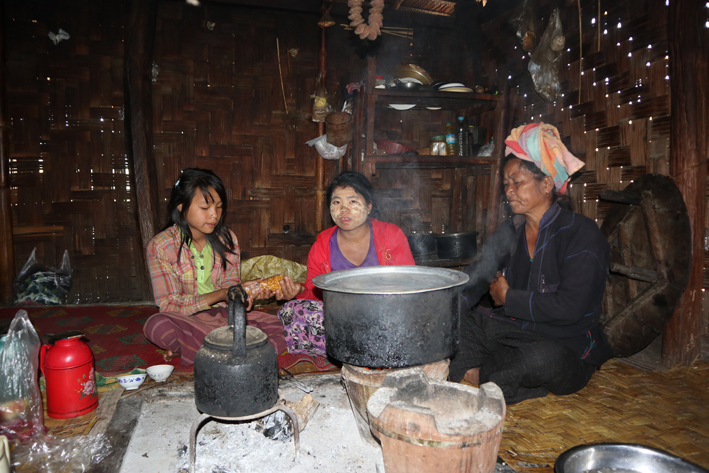 Taung Yo family members in the kitchen at the house where we stayed. The fire is in the middle of the room, so during the winter you can sleep round it. Afterwards we wished we'd had that option - it gets really cold at night!
