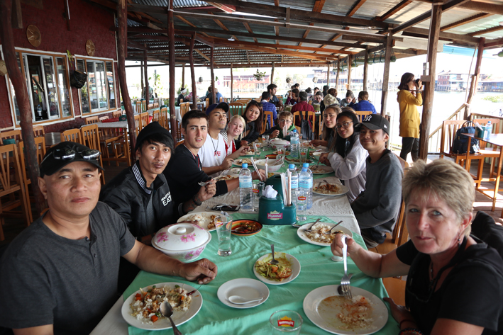 Putting money into the local economy. Lunch at a family-owned restaurant at Nan Pan village