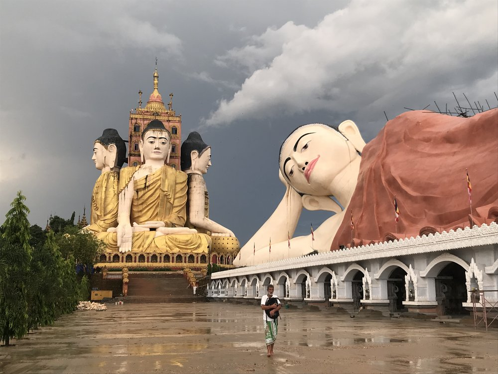 A huge reclining Buddha has been added to the already impressive four sitting Buddhas around a tower at Banana Mountain (Ko Yin Lay), outside Ye