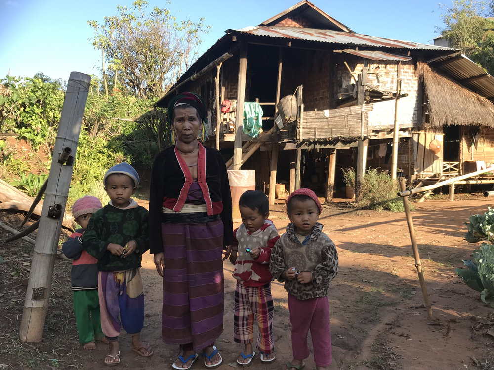 A proud grandma outside her house in Pankam village, near Hsipaw