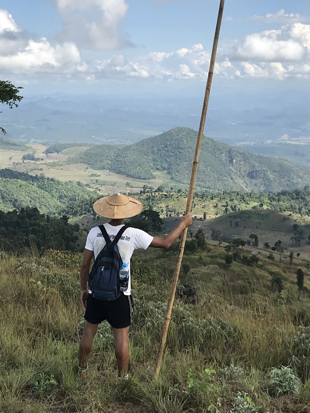 Our Hsipaw guide Sai posing with a large stick whose function wasn't totally clear