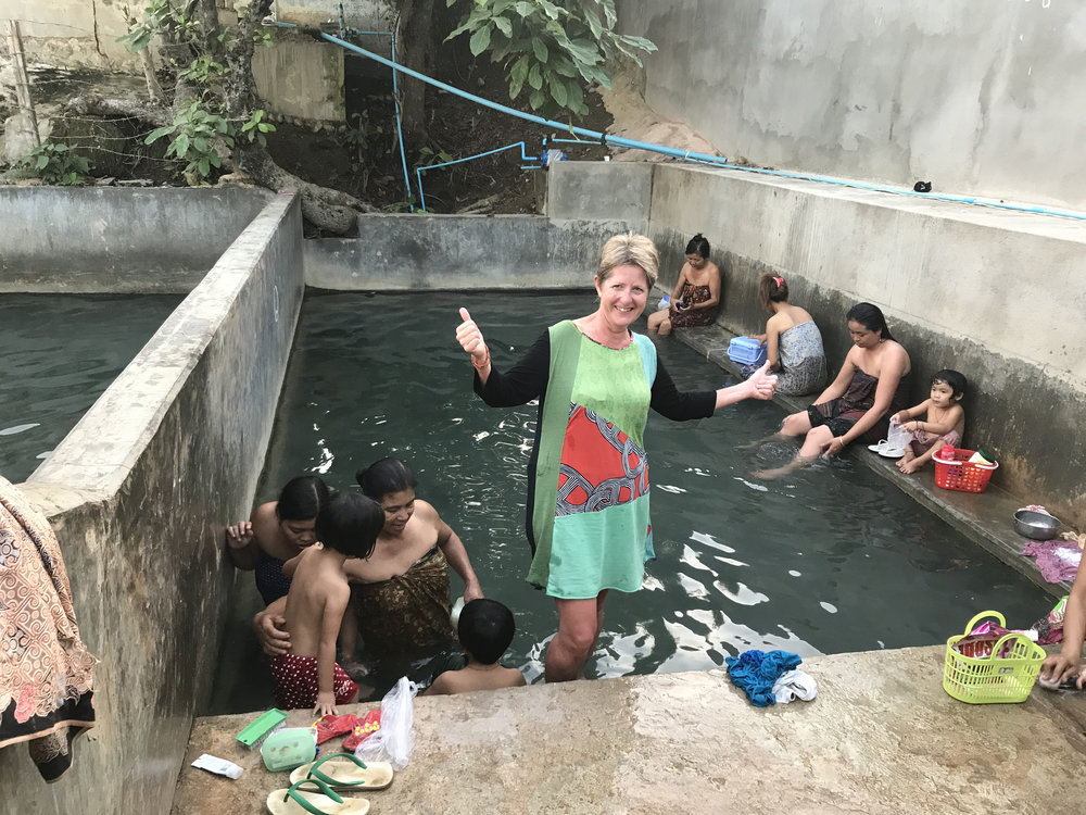 Joining the locals in the hot springs at the end of the trek