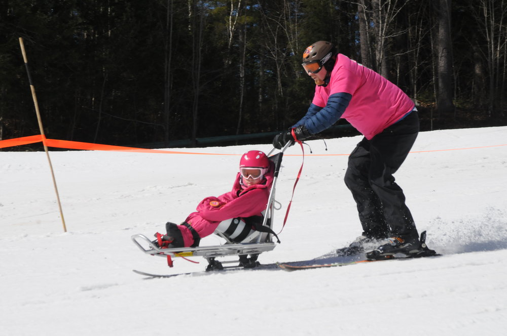 Sammy Gillard and her father Geoff Gillard skiing at King Pine Ski Area