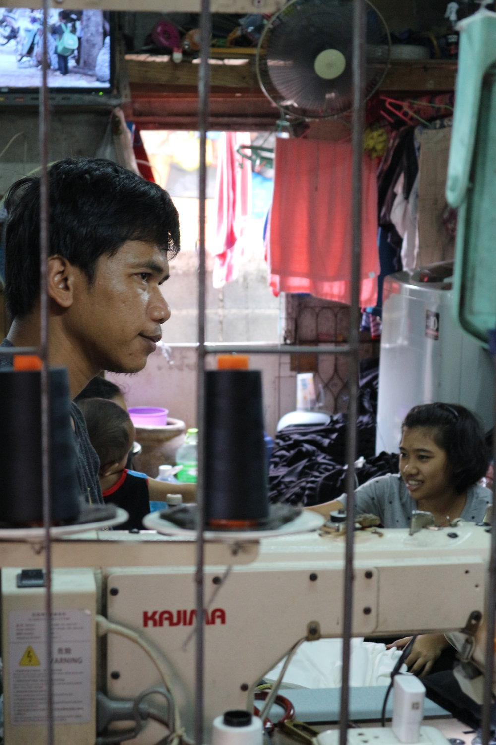 Photo of home-based garment workers on the outskirts of Bangkok: copyright - Shelley Marshall