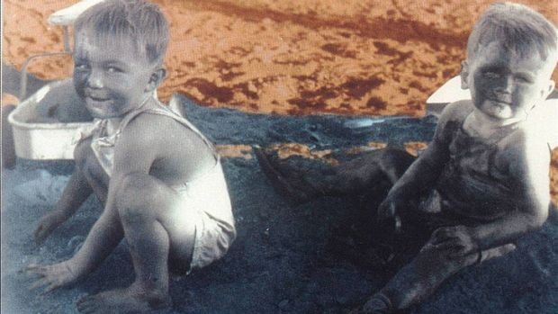 Children playing in a 'sandpit' full of deadly blue asbestos tailings.
