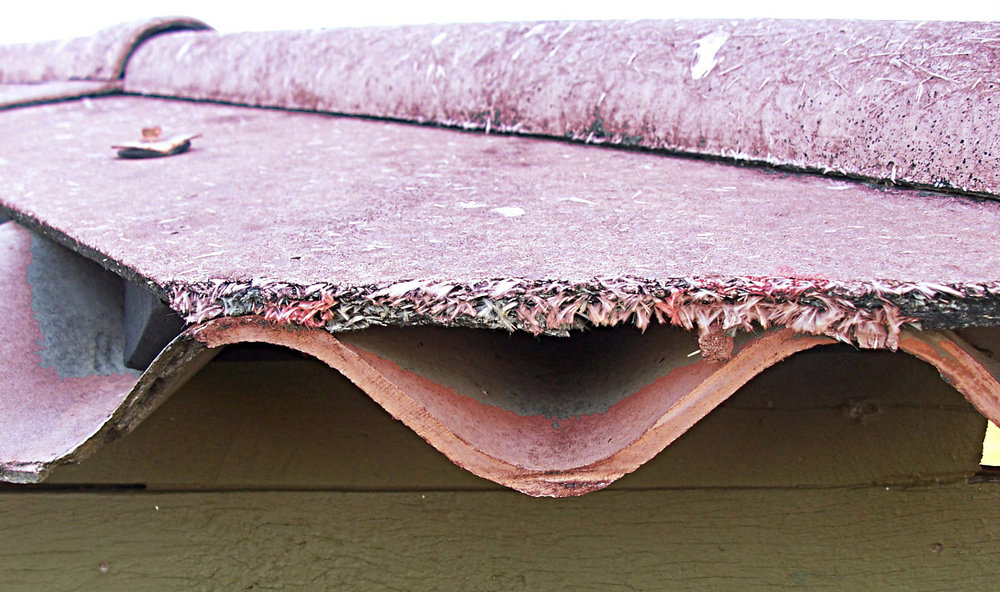 Corrugated asbestos cement sheeting and asbestos cement sheeting: two examples of non-friable asbestos.
