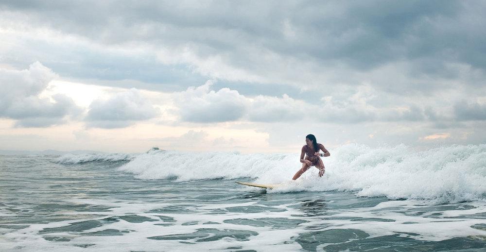 Patricia Pinto surfing. Photo credit:Morten Sølvstrøm.