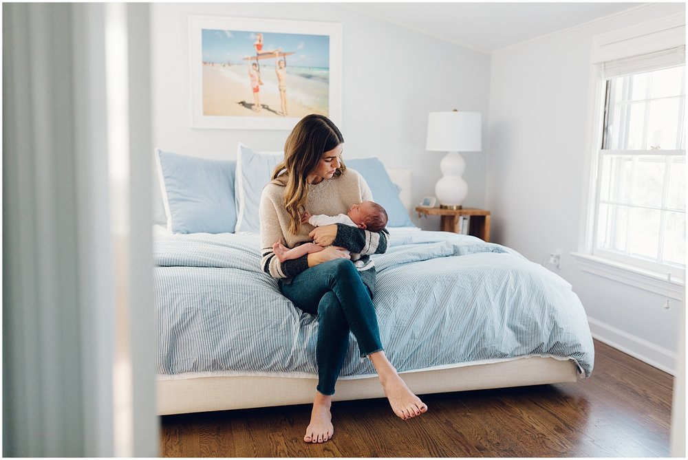 Mother and Newborn Son In Blue Bedroom