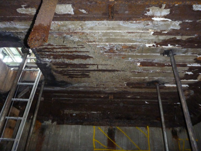 Severely corroded steel sheeting within the caisson