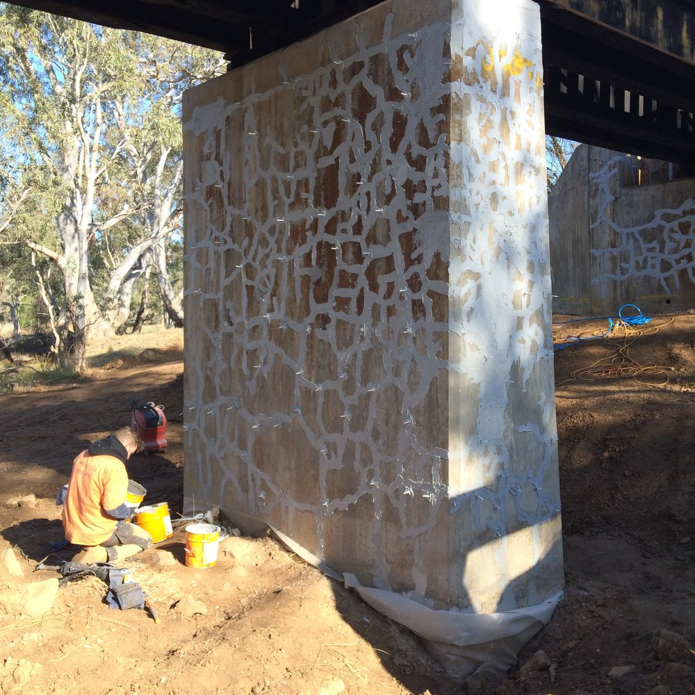 Concrete column being prepared for crack injection.