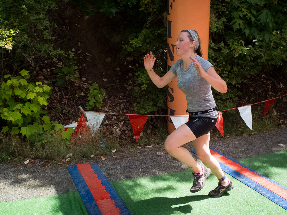 Liz Francis storming across the finish line of the XTERRA Victoria