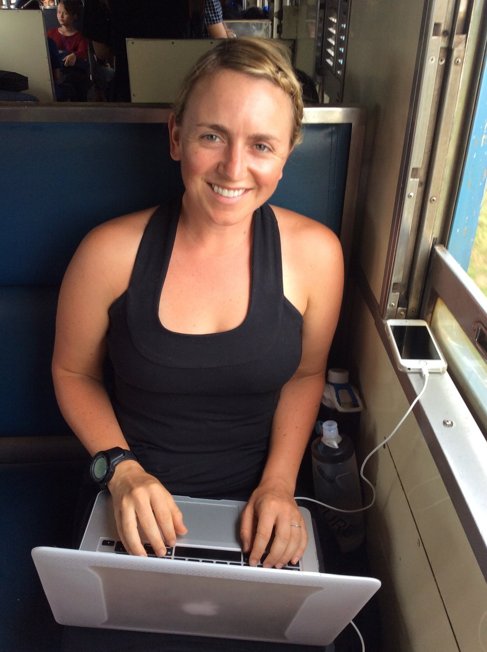 Work when you can. This was on a hot and sweaty train ride between the Cambodian border and Bangkok, Thailand.