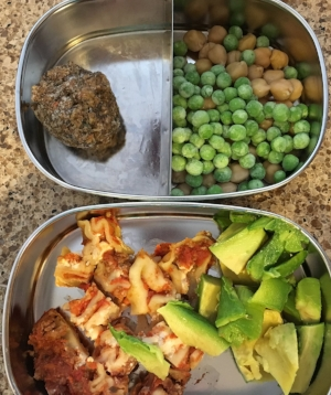 Chopped leftover lasagna and avocado slices with frozen peas, chick peas and a muffin