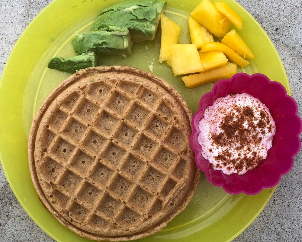 Day 1 - Waffles, fruit, avocado, and yogurtHere I combine a frozen waffle (I love Trader Joe's and Van's brands) with fruit and some healthy fat from the avocado and yogurt. We used frozen mango, I keep a bag on hand for smoothies but also provide this when I don't have fresh fruit available. Other frozen fruit works really well too, like blueberries and peaches.