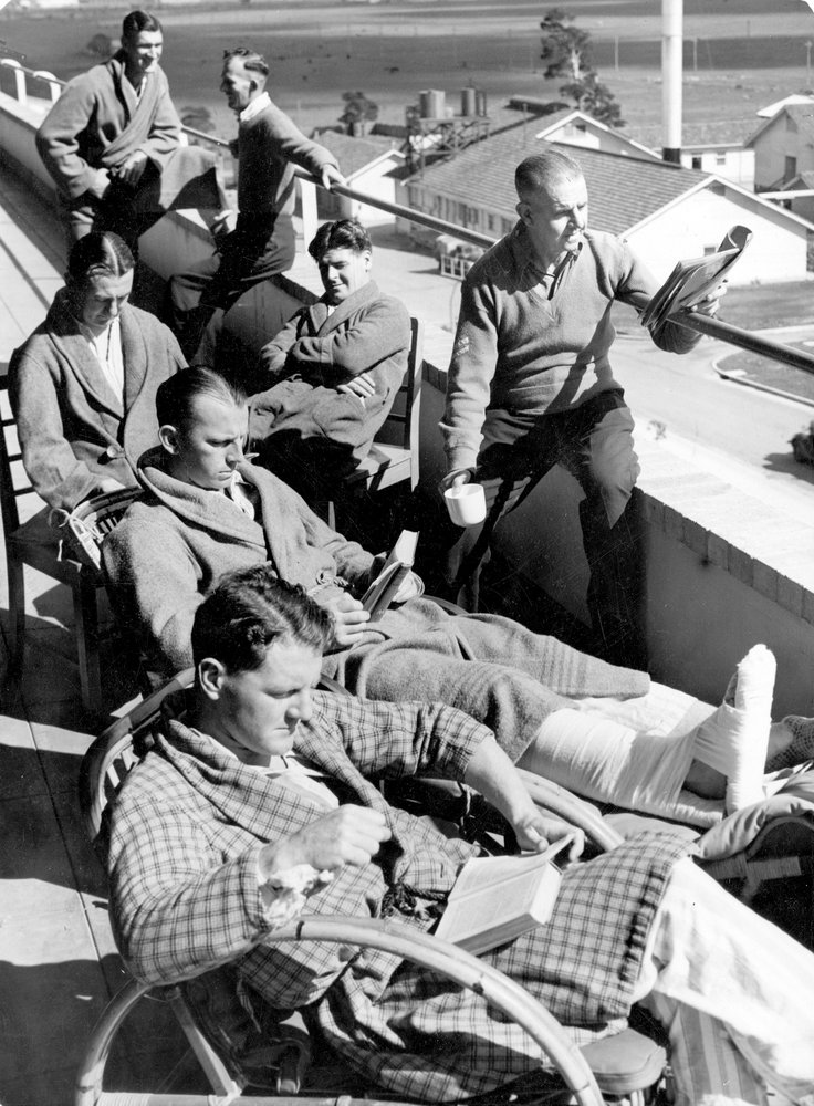 Enjoying the sunshine from one of the top verandahs at Heidelberg Repatriation Hospital, c1940-46. Image courtesy  SLV