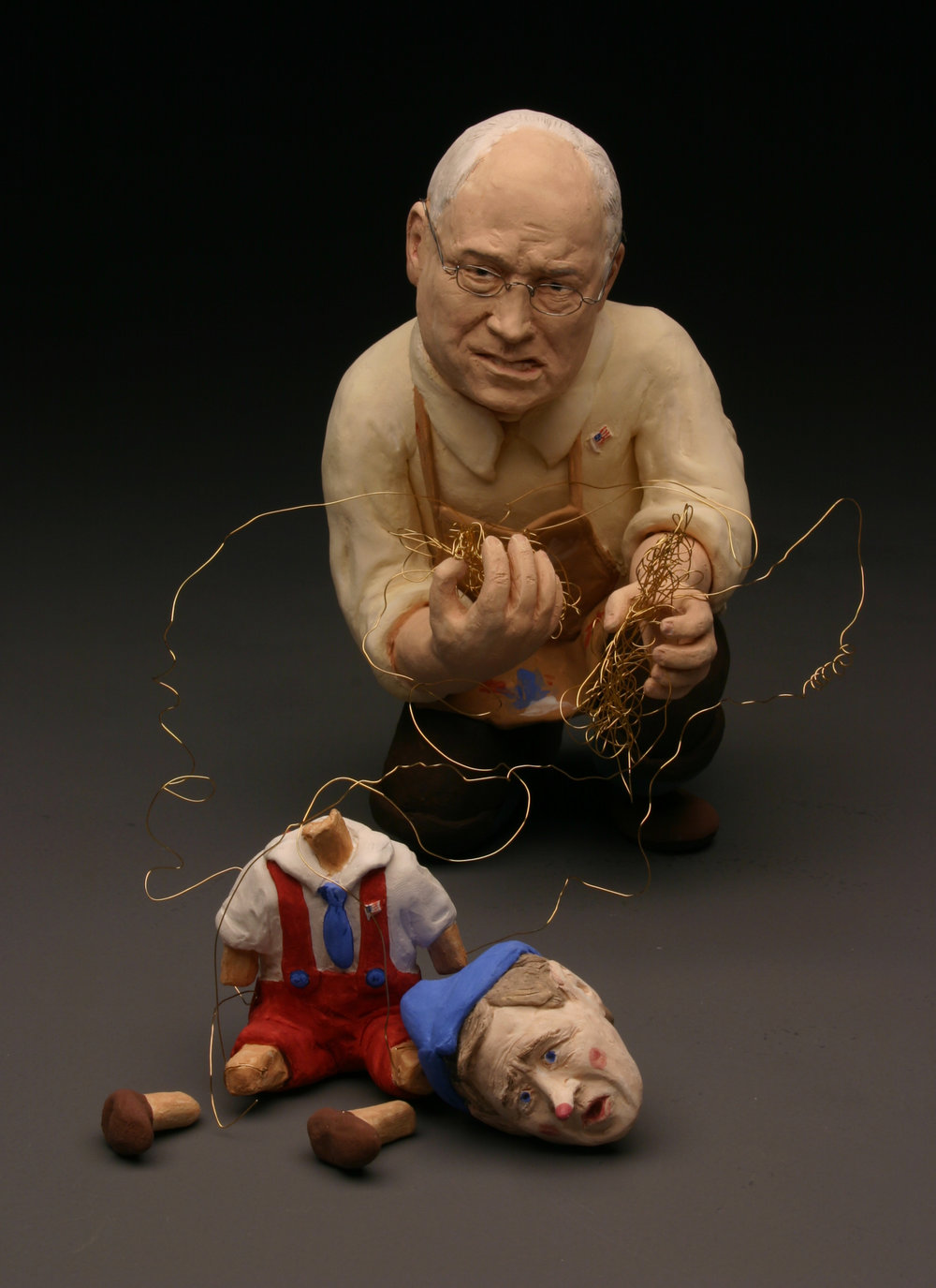"SHADOW GOVERNMENT ,  2005  bisqued porcelain, underglazes, wire  10"" by 6"" by 4"""