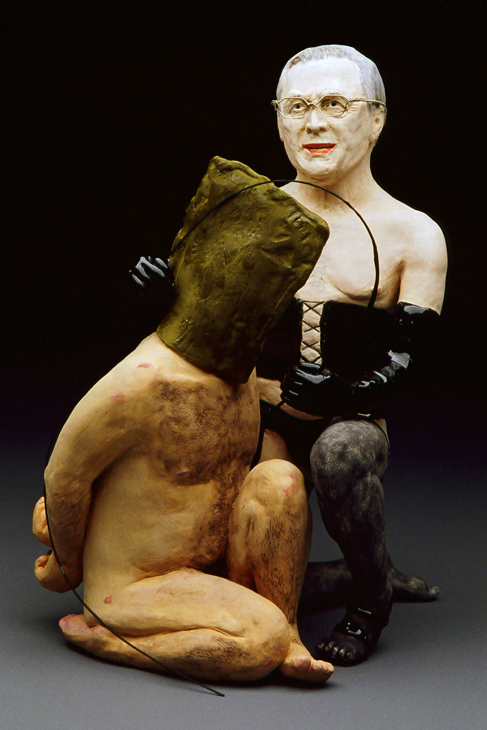 "IRAQI HORROR , 2004  9.5"" by 6.25"" by 6""  bisqued porcelain, underglazes, low-fire glazes, guitar string"