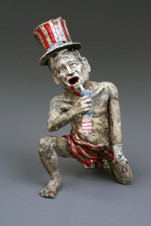"Uncle Sam Devouring His Children   Glazed ceramic. 7""h x 4""w x 5""d  Spring 2006"