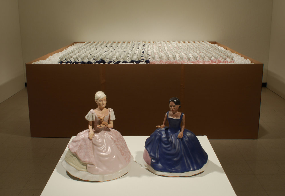 "Bellum and Antebellum  (foreground) &  Over-Indentification with the Other   porcelain, glaze, cardboard, packing peanuts and screen-printed silk  box installation: 9 ft x 9 ft, Bellum & Antebellum, 11"" h x 5"" deep x variable width  2008"
