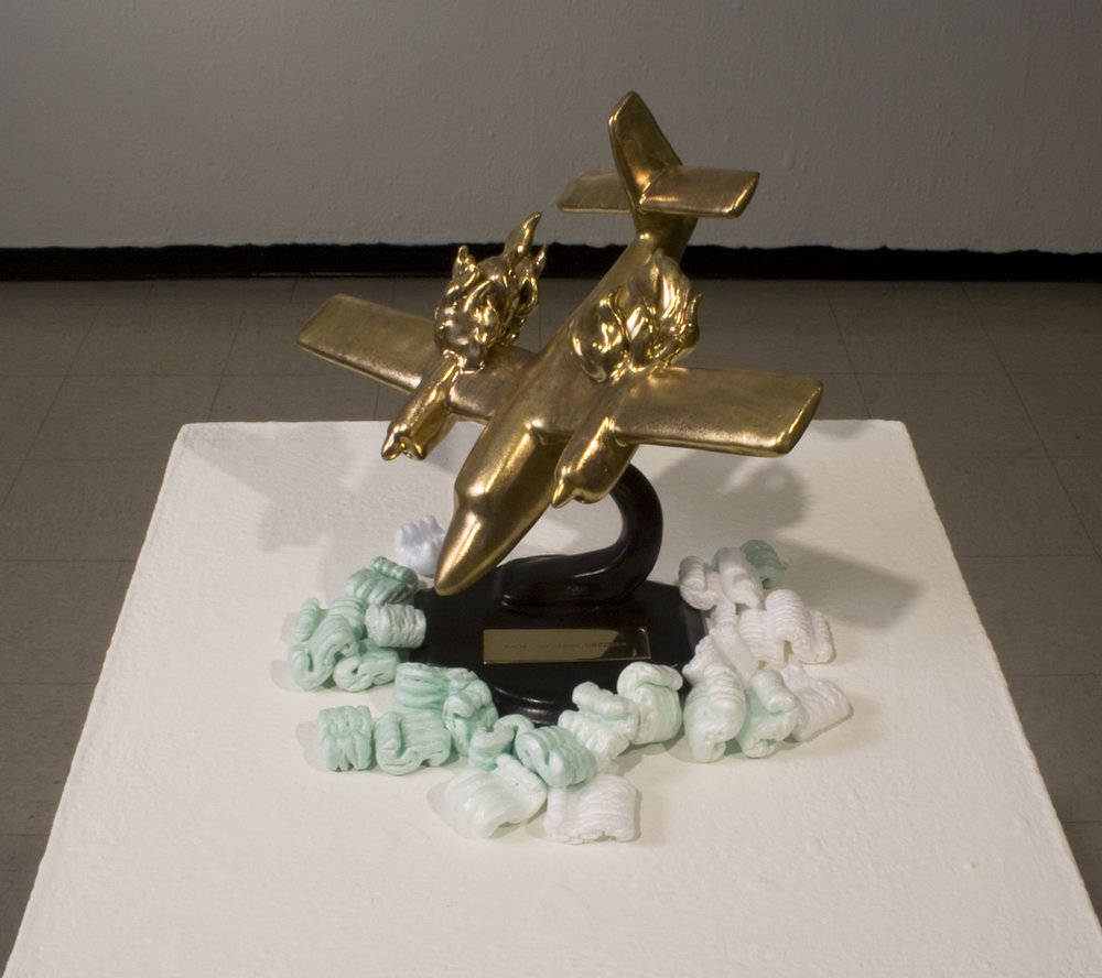 "Landscape with the Fall of Torrijos / There are Others  Glazed cone 5 porcelain, gold luster, brass, styrene peanuts Approx 10"" h x 8"" w x 8"" d 2008"