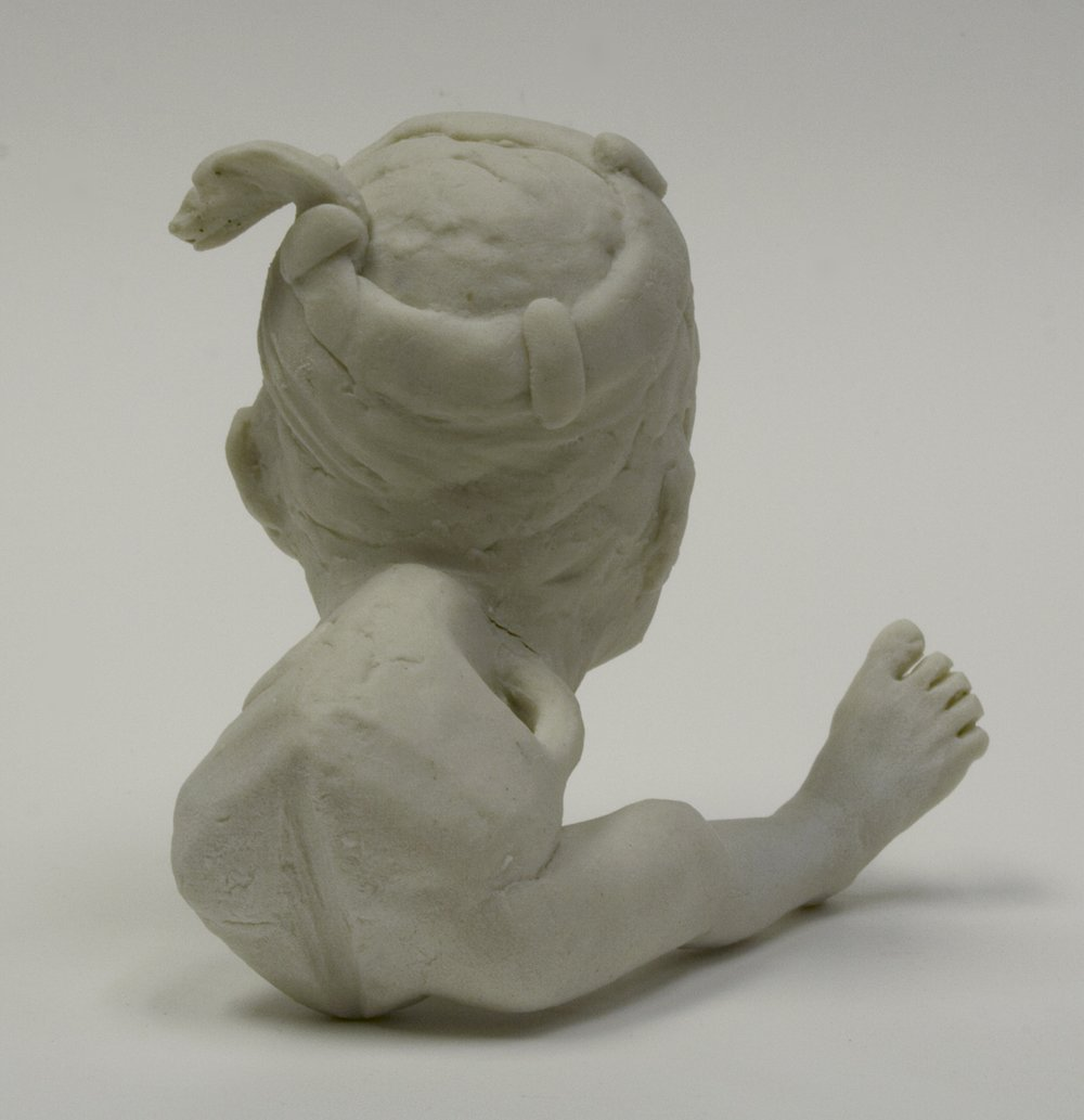 "detail:  Portrait of the Artist as a Commodity, #1.2    unglazed porcelain, approx 2.5"" h  Spring 2007"