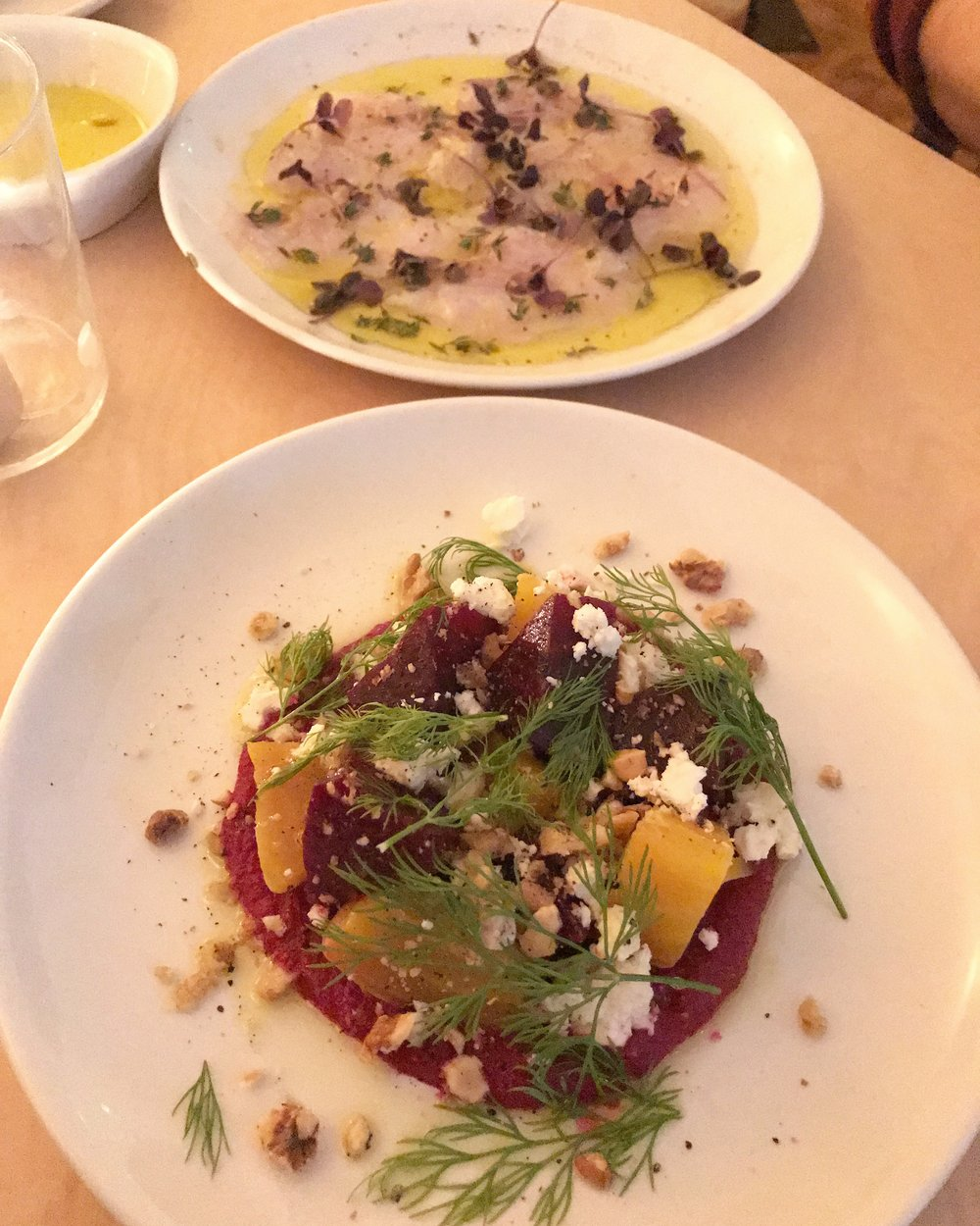 Beetroot, feta, walnut and dill with sea bass ceviche at the back